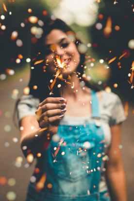 woman holding firecracker